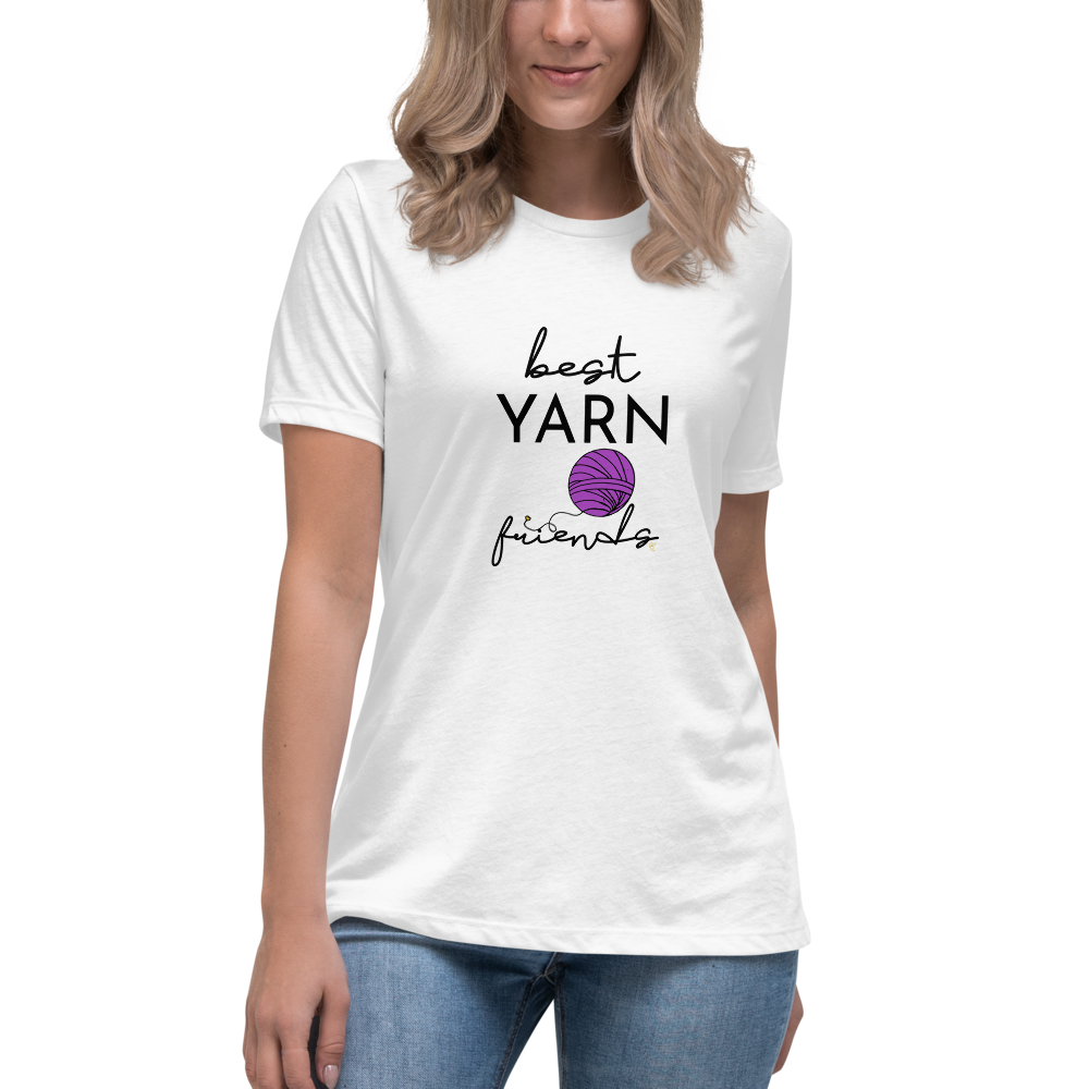 woman smiles wearing white shirt with best yarn friends graphic