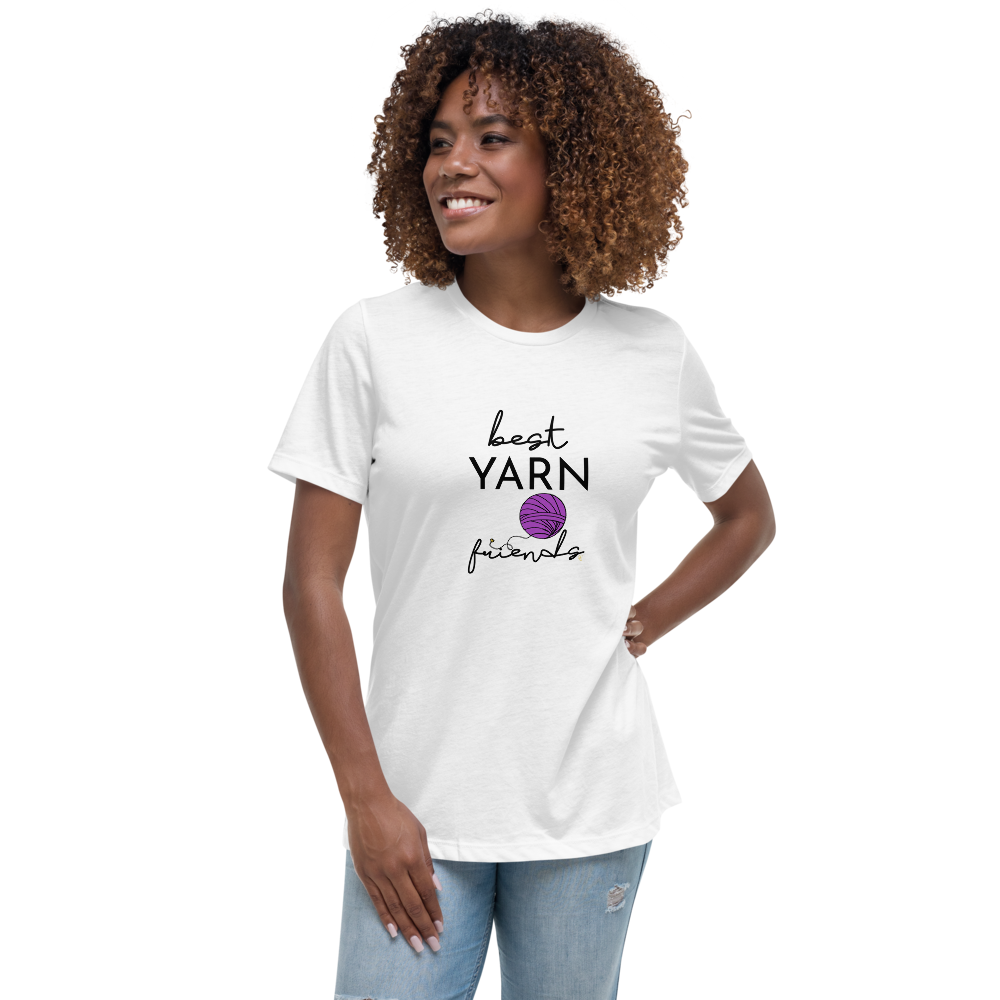 woman smiles with hand on hip wearing white shirt with best yarn friends graphic