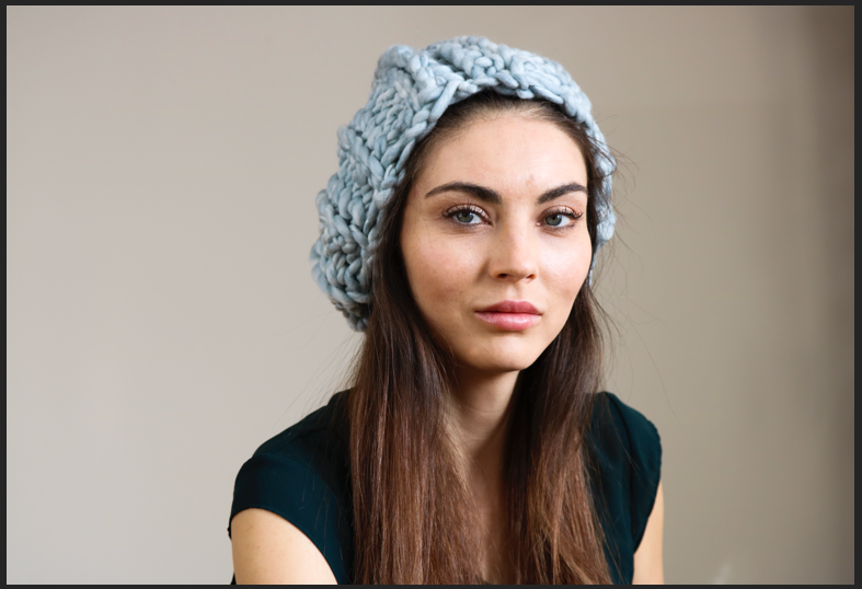 Model wears sage green wool hat