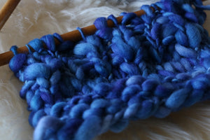 Blue swatch of thick & thin merino yarn