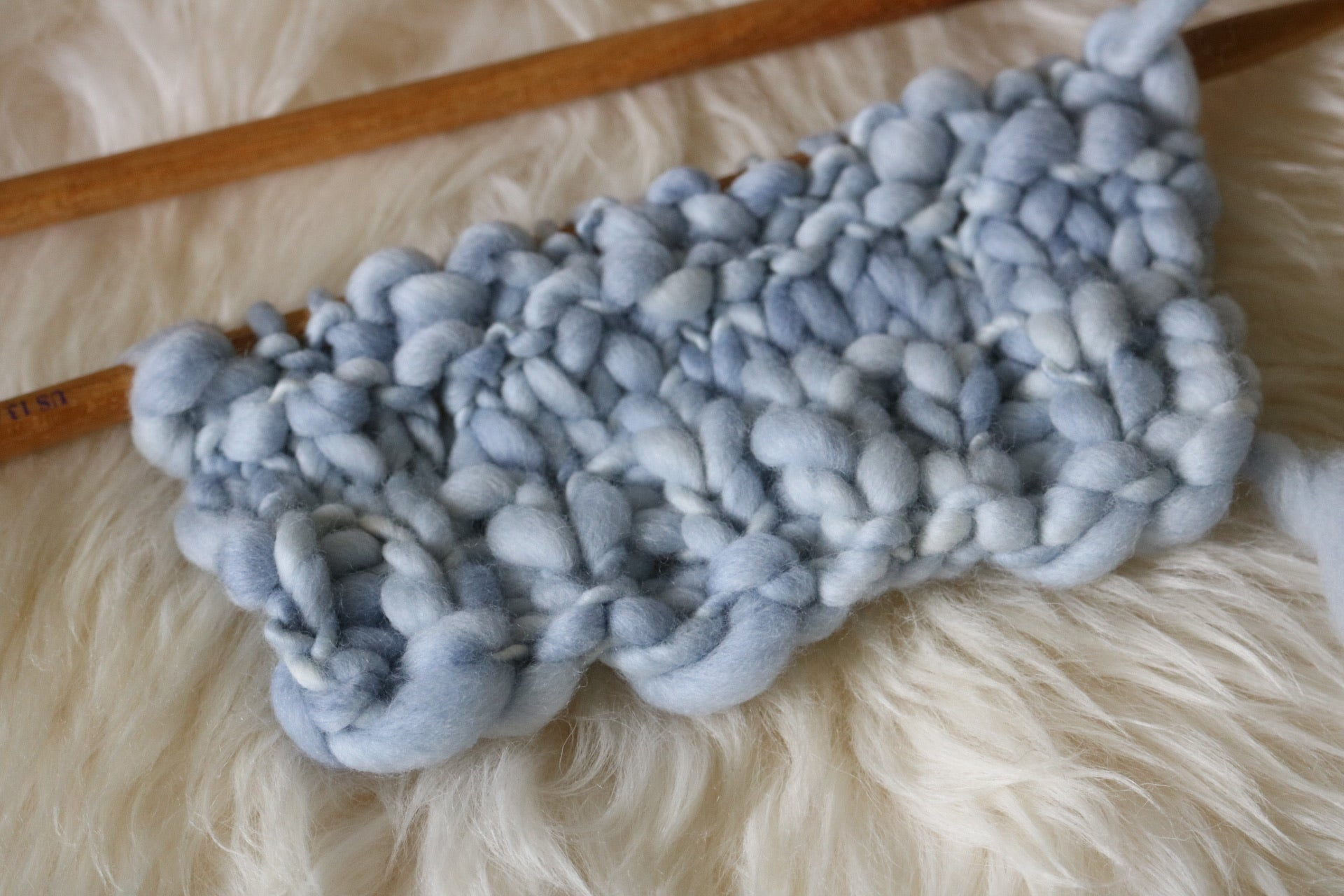 swatch of merino yarn on knitting needles