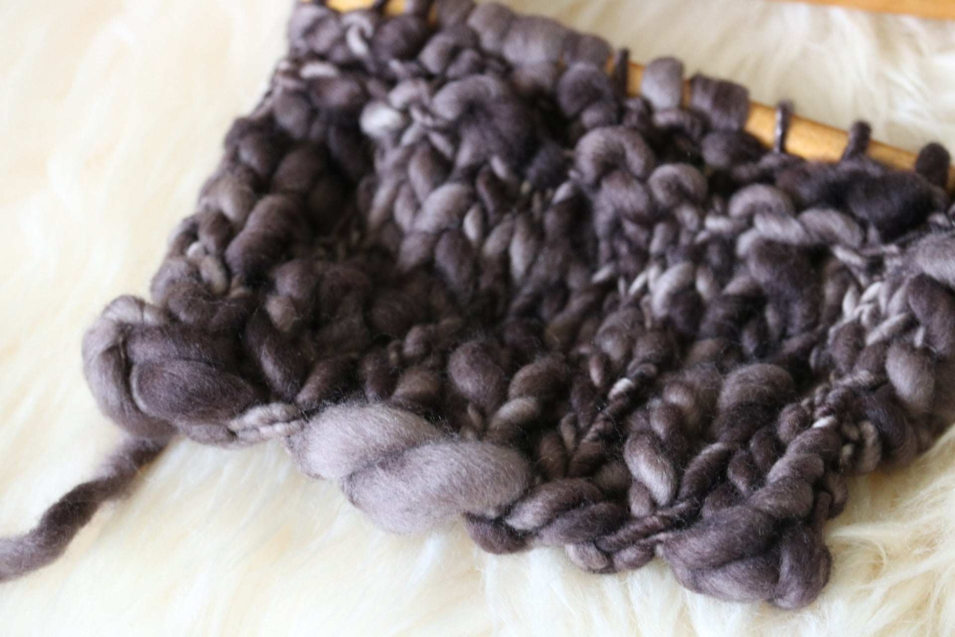 knit stitches in brown thick and thin yarn