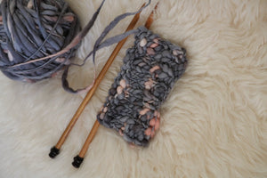 A knitted swatch of handspun yarn