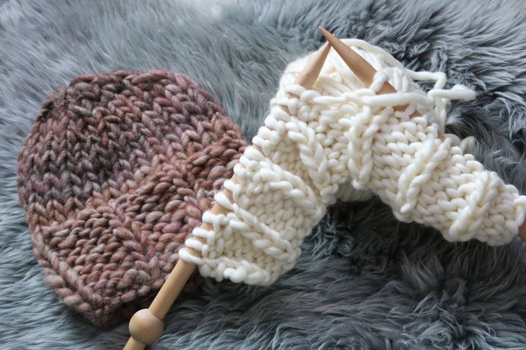 knitting needles creating ribbed hat brim