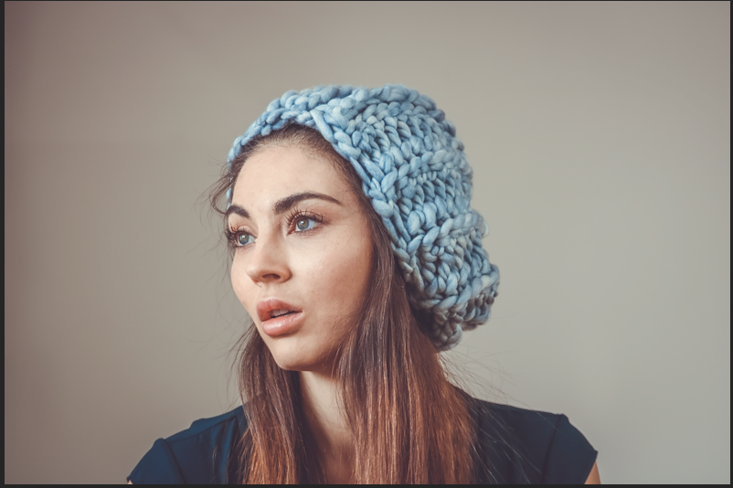 Model wears wool crochet hat