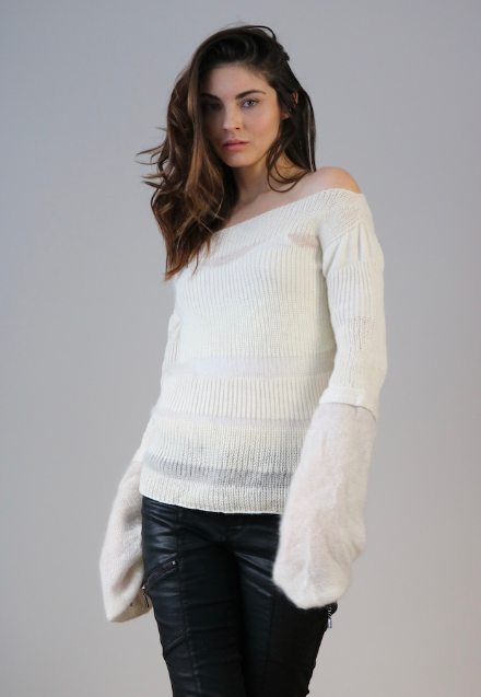 Model wearing natural white sweater