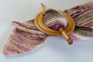 apple and Amur cherry wood shawl pin assembly holds knitted shawl