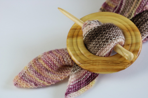 wooden shawl pin holding pink and brown scarf