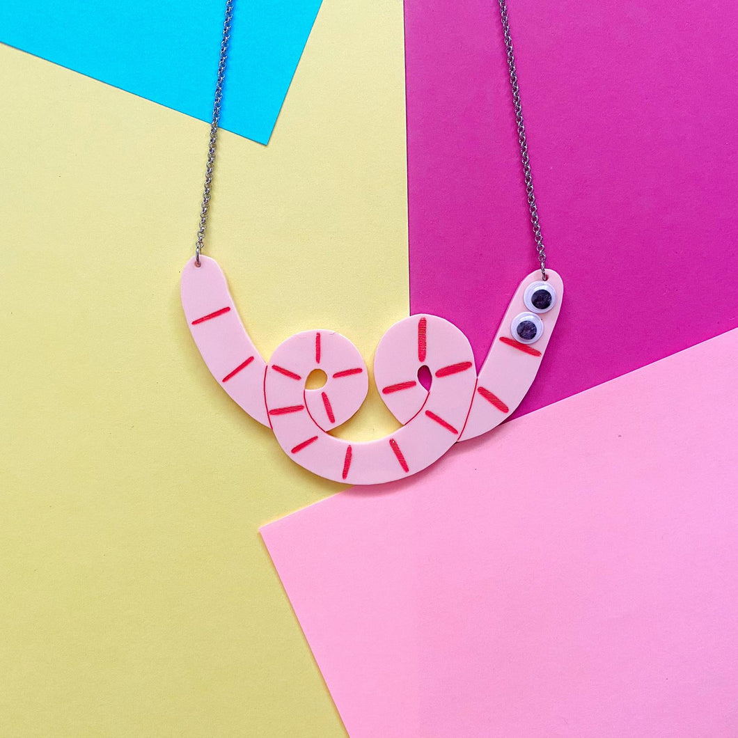 Pink squiggle-shaped Werm necklace