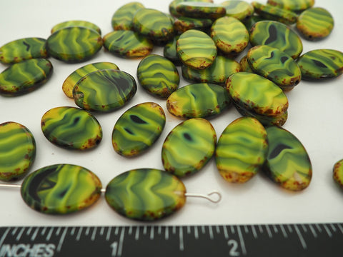 12pcs of Czech Glass Table Cut Oval Window Beads in size 20x14mm, side drilled, Green Opal Swirl with Picasso coating Art. 151-99006, col. 26807/86800