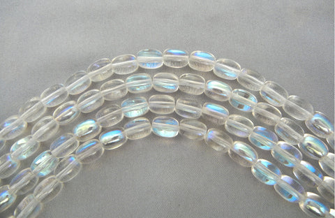 23 Czech Glass Druk Beads 9x7mm Crystal AB smooth oval, pressed, clear AB coated, P202