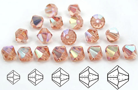 Light Peach AB, Czech Glass Beads, Machine Cut Bicones (MC Rondell, Diamond Shape), pale pink crystals coated with Aurora Borealis