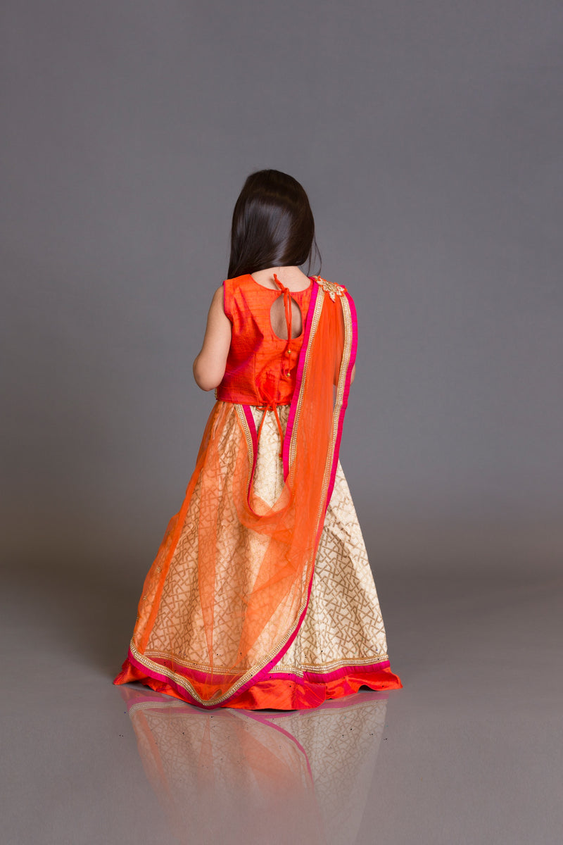Kidswear orange top with jamawar skirt and orange net dupata