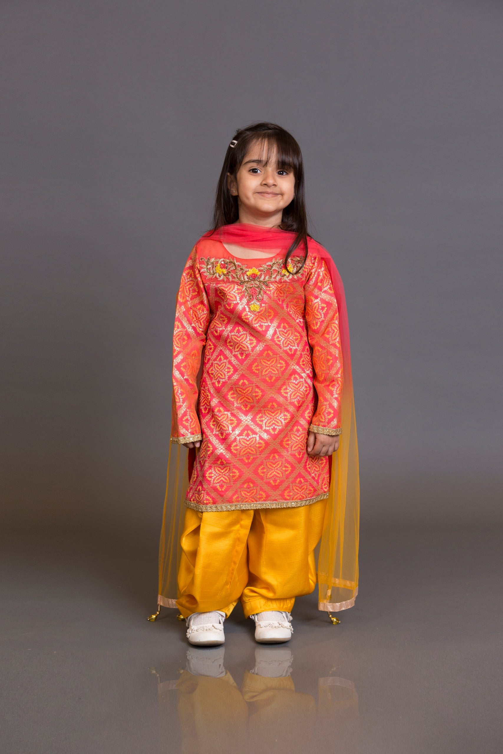 Kidswear long kameez with yellow dhoti and net dupata