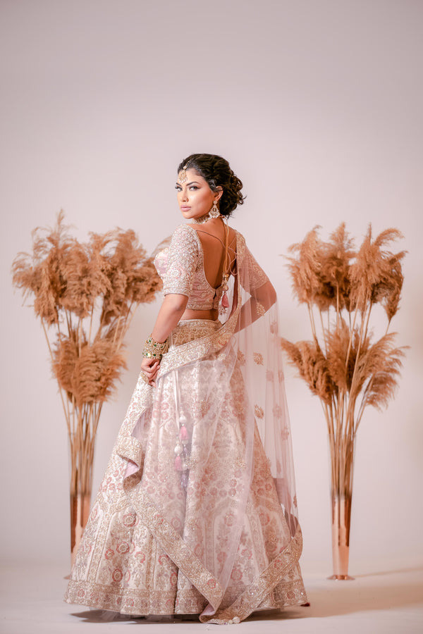 Ivory silk Lehenga with embroidered Corset Blouse