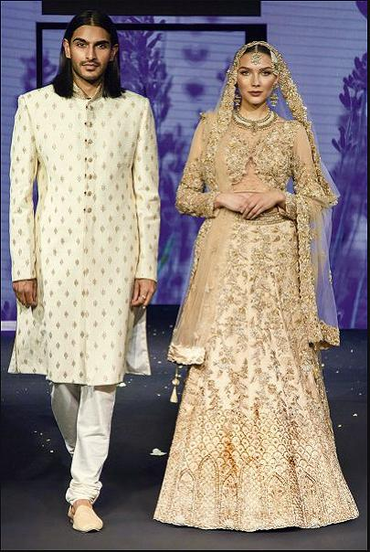Heavy Golden Bridal lehenga and Ivory Sherwani