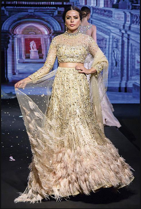 Golden bridal lehenga with feathers