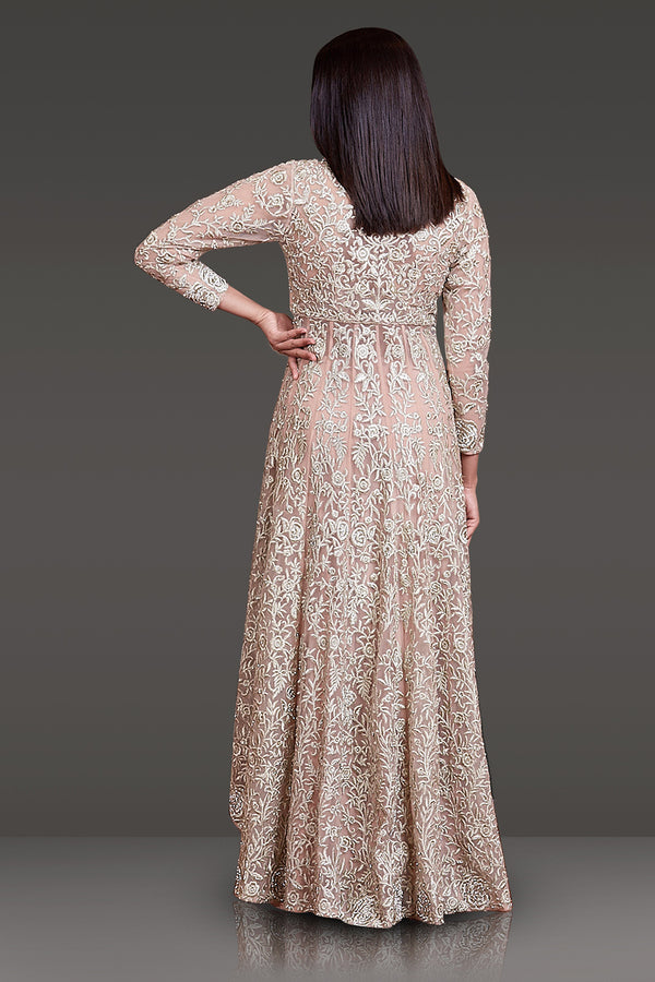NUDE COLOR HIGH LOW PEPLUM TOP WITH ALL OVER ZARI WORK PAIRED WITH A PAIR OF SHARARA PANTS AND NET DUPATTA