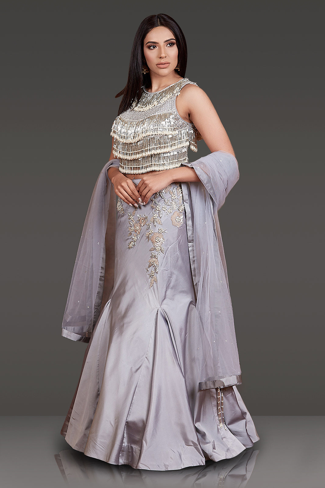 GREY TOP FULL EMBROIDERED AND TASSELS ON IT WITH FISH CUT SKIRT WITH EMBROIDERY NET SCARF