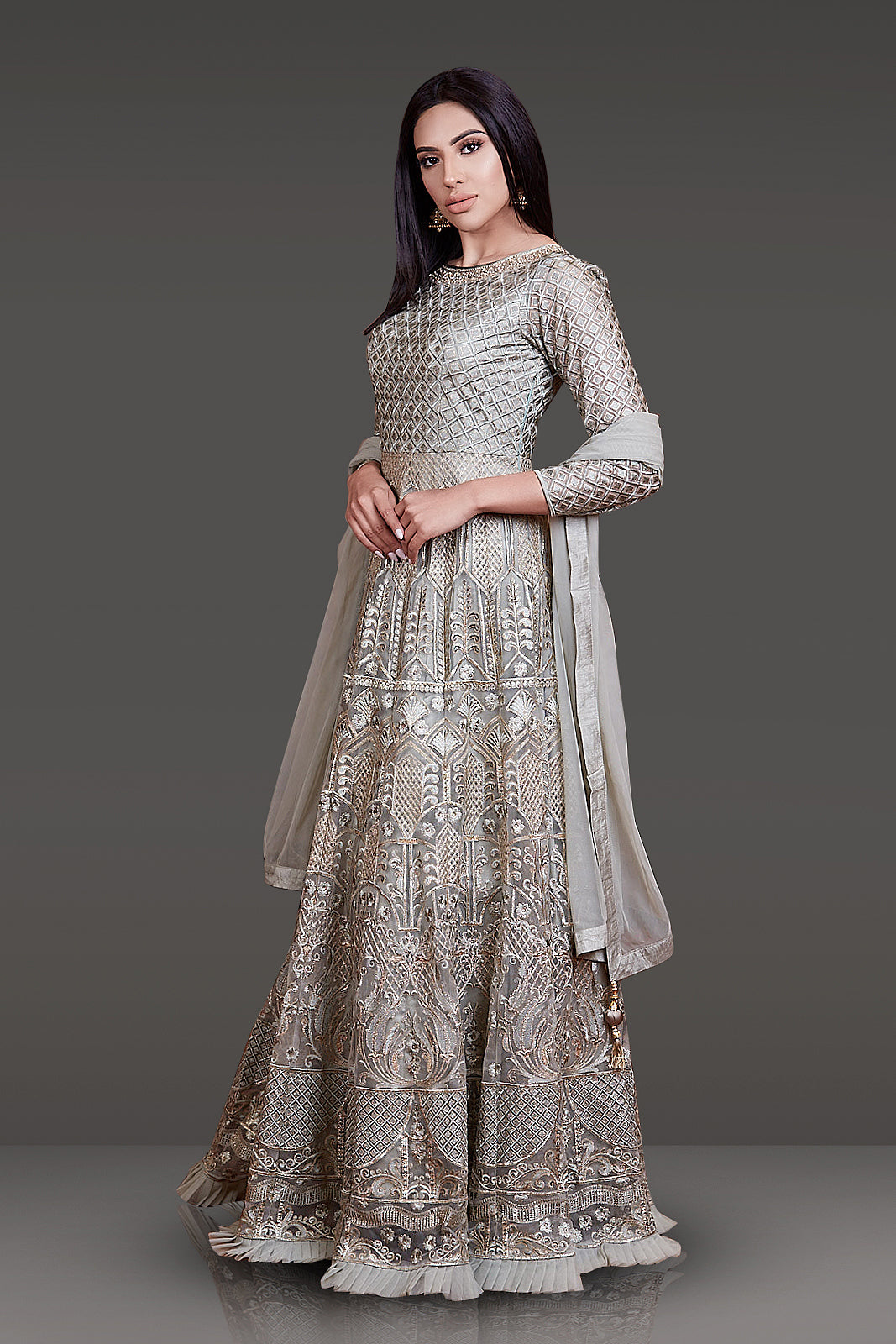 OLIVE GREEN COLOR TONE TO TONE THREAD WORK ANARKALI WITH ZARI HIGHLIGHTING AND NET DUPATTA PAIRED WITH LYCRA CHURIDAR