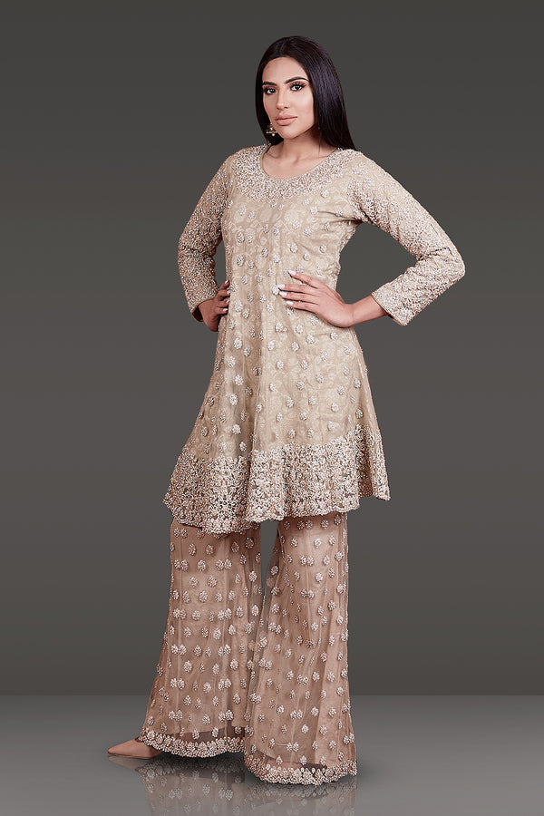 GOLD COLOUR NET KAMEEZ WITH TONE TO TONE RESHAM WORK HIGHLIGHTED WITH STONE EMBROIDERY UNDERLINED WITH BANARSI FABRIC PAIRED WITH A PAIR OF SHARARA AND NET DUPATTA