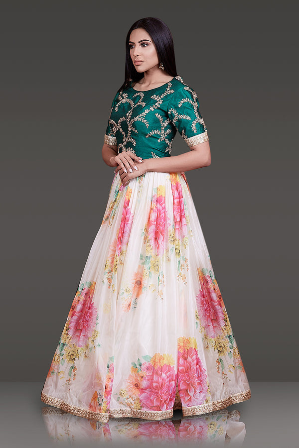 FLORAL ORGANZA SKIRT WITH THE FLORAL ORGANZA DUPATTA PAIRED WITH EMERALD GREEN RAW SILK TOP FILED WITH GOTTA PATTI EMBROIDERY