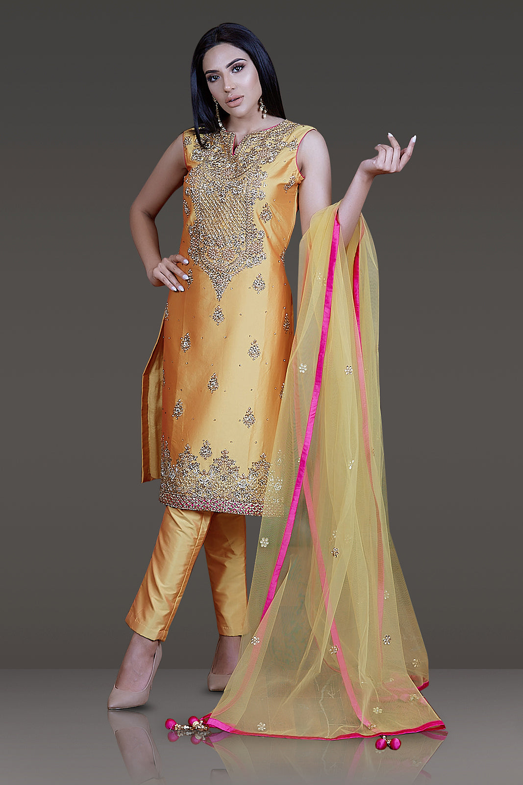 MUSTARD YELLOW TAFTA SILK STRAIGHT KAMEEZ/SUIT PAIRED WITH TAFTA PANTS AND NET DUPATTA EMBOSS WITH KUNDAN AND STONE EMBROIDERY
