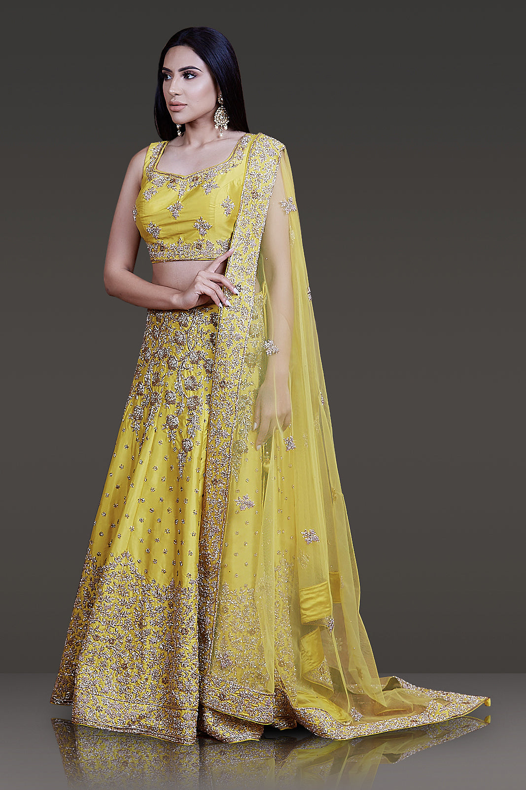 Bright Yellow Taffeta Silk Lehenga-Top-Dupatta Embossed with Ivory Gold and Stone Work