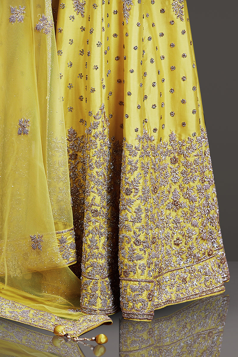 BRIGHT YELLOW TAFTA SILK LEHENGA/TOP/DUPATTA EMBOSSED WITH IVORY GOLD AND STONE EMBROIDERY