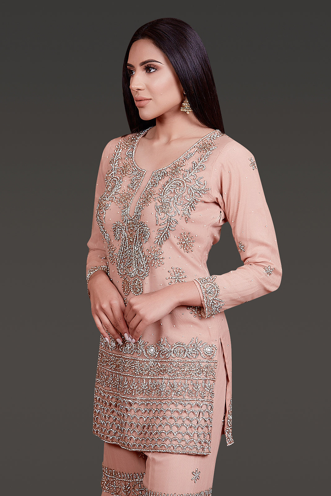 DARK NUDE COLOUR KAMEEZ WITH SILVER ZARKAN EMBROIDERY AND CUTWORK ON THE BORDERS PAIRED WITH A NET SHARARA AND NET DUPATTA