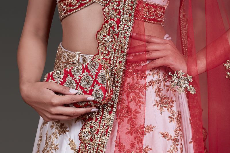 WHITE COLOUR TAFTA SILK LEHENGA,TOP AND DUPATTA WITH DABKA EMBROIDERY PAIRED WITH RED DUPATA