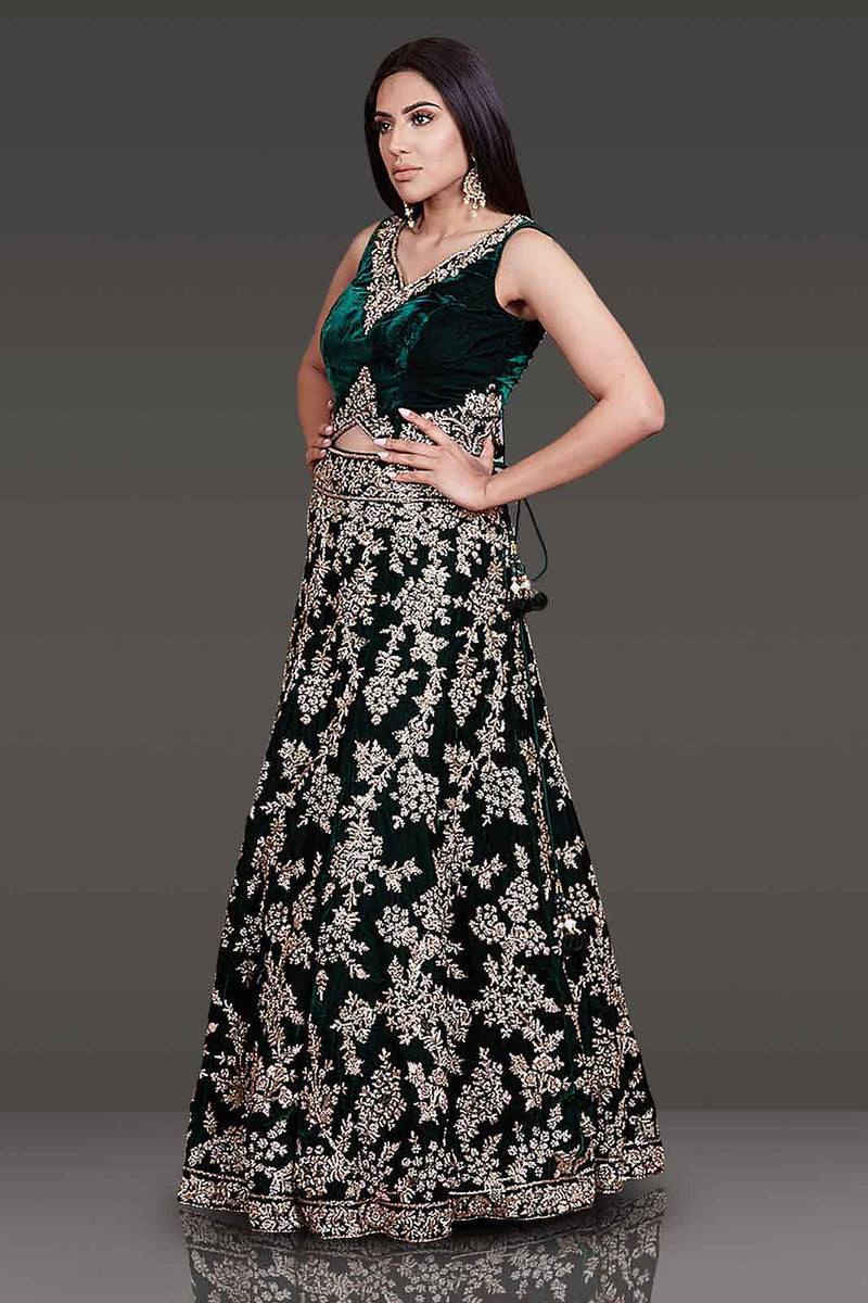 Bottle Green Micro Velvet Bridal Lehenga And Top With Gold Zardozi And Stone Embroidery