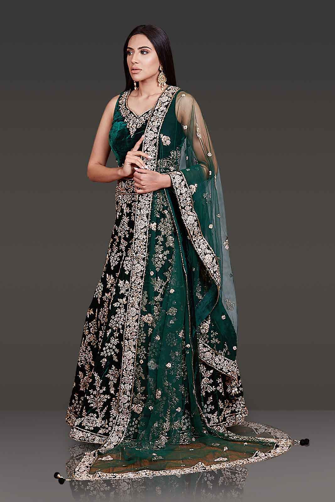 Bottle-Green Micro-Velvet Bridal Lehenga with Gold Zardozi top and Stone Embroidery