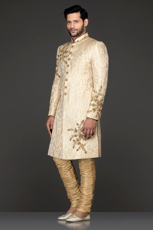 Ivory Gold Brocade Sherwani With Gold Dabka Embroidery Paired With Gold Chudidar