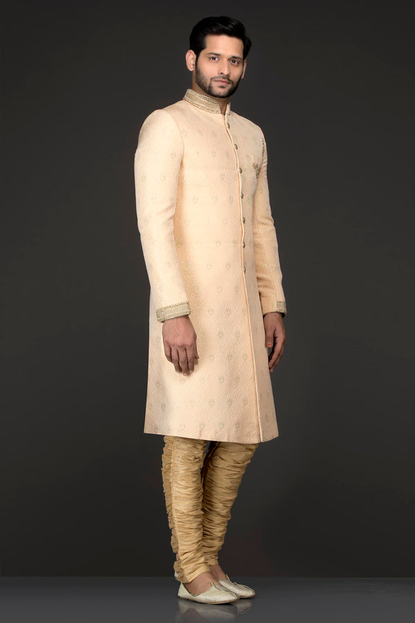 Peach Brocade Sherwani With Silver Dabka Embroidery Paured With Gold Chudidar