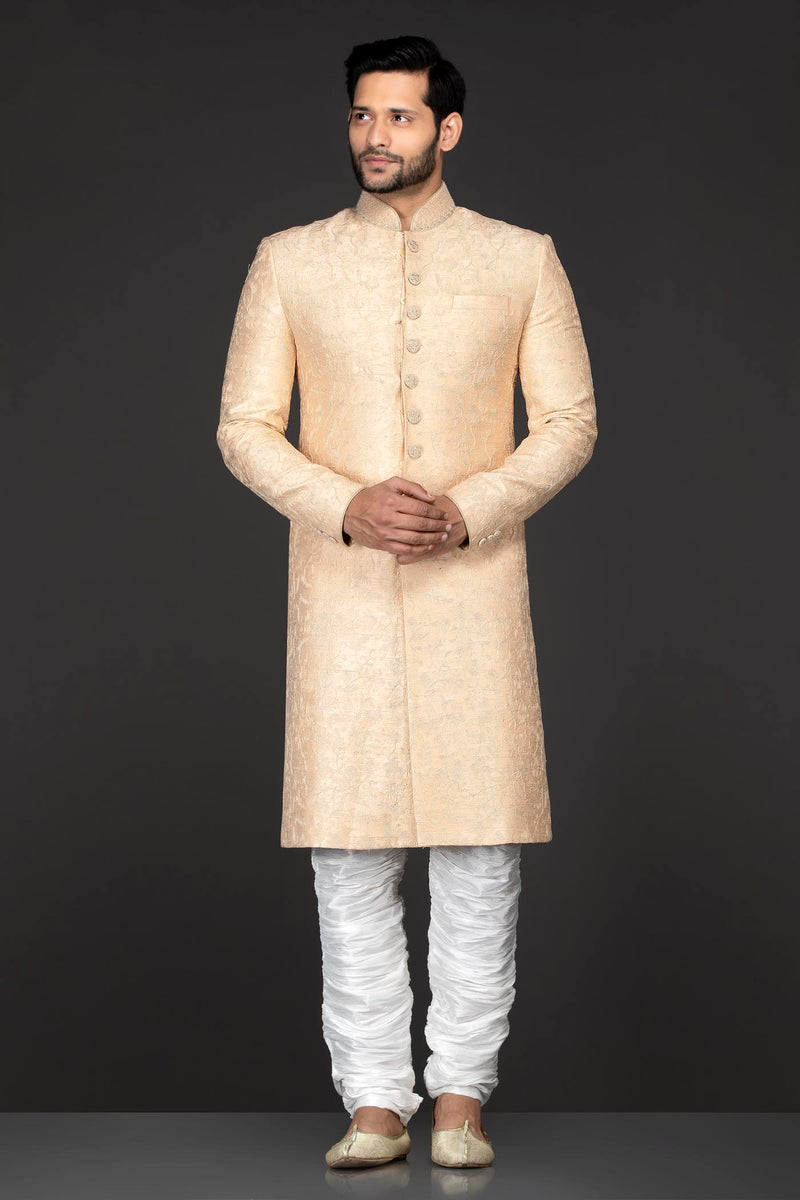 Peach Brocade Sherwani With Embroidery Buttons Paired With White Trousers