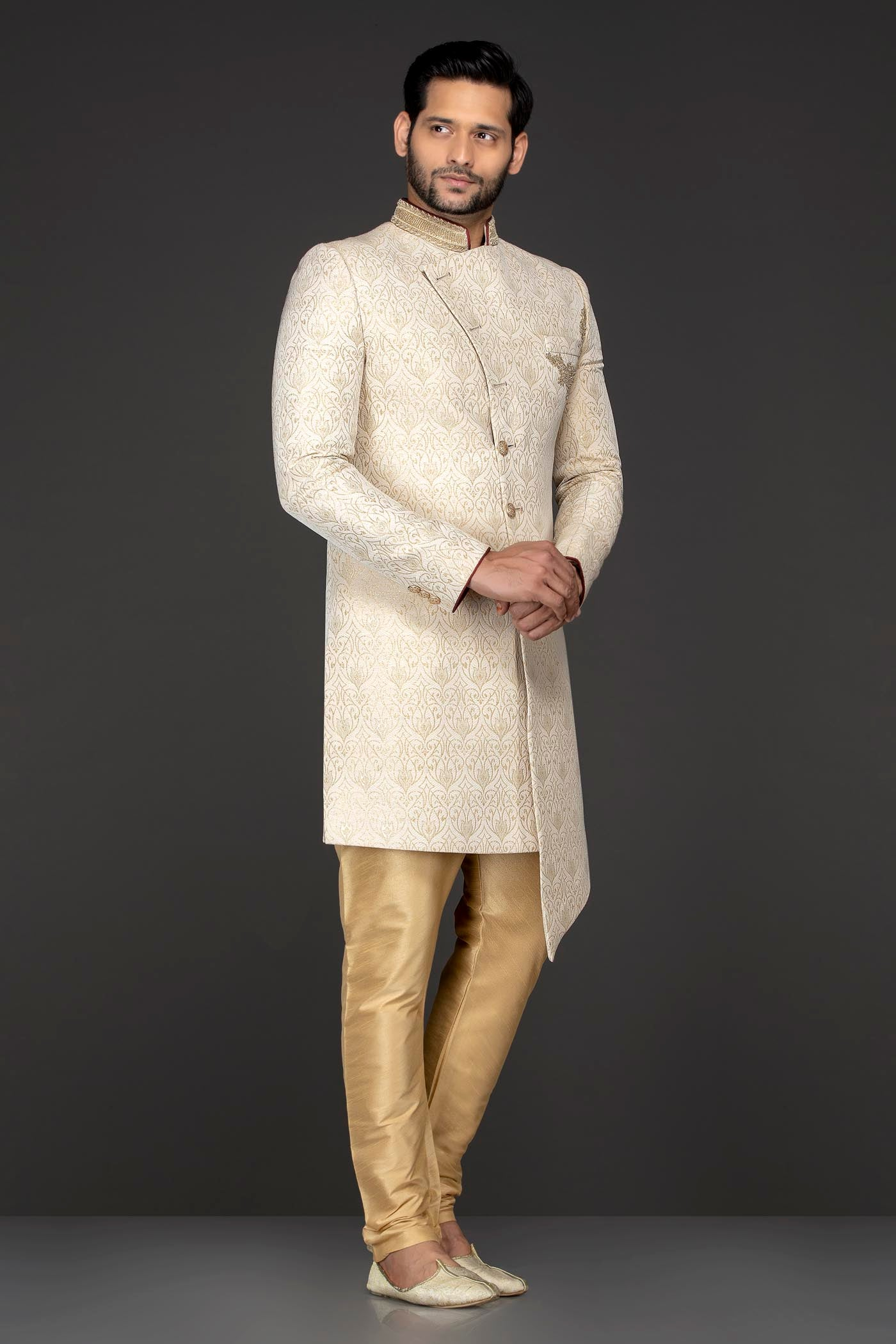 Gold Brocade Asymetrical Sherwani Paired With Antique Gold Silk Trousers