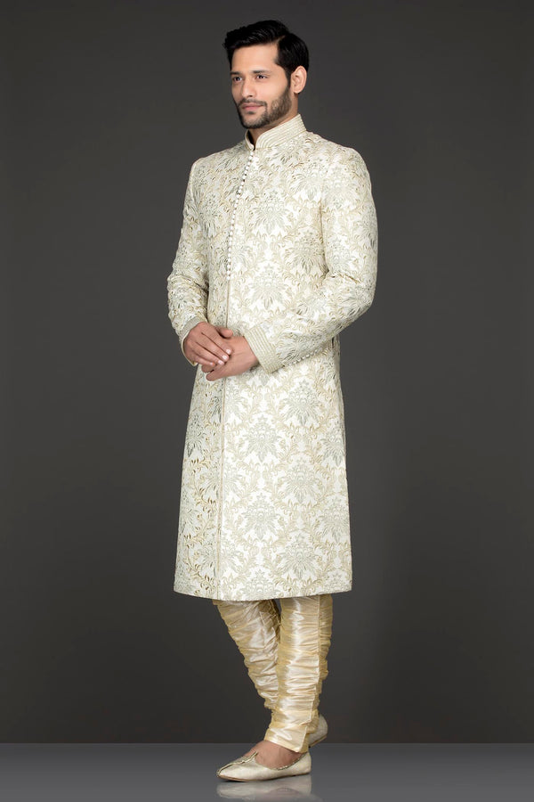 Ivory Colour Silk Sherwani With Silver Zari And Dori Embroidery Paired With Gold Bottoms