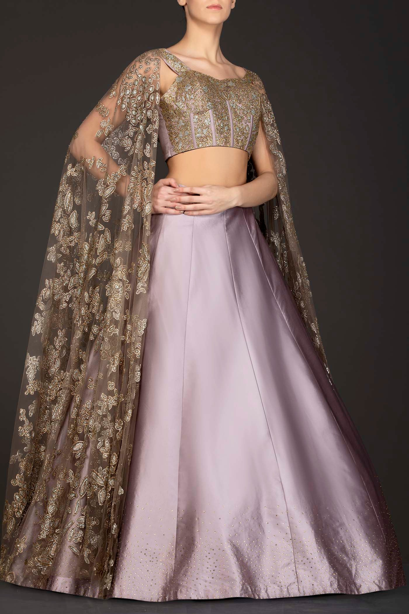 Mauve Colour Silk Skirt With Heavily Embriodered Net Top And Attached Net Cape