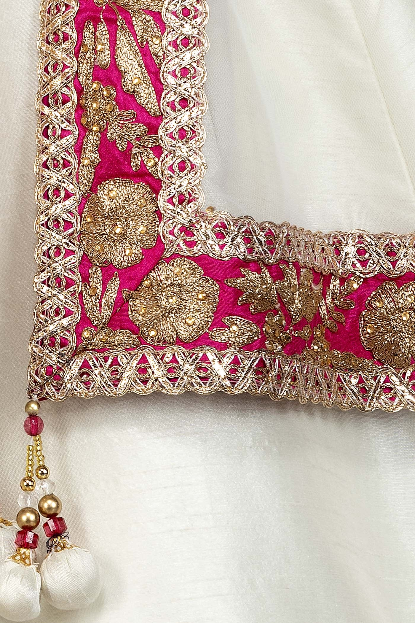 Fuchsia Pink Silk Top With Ivory Silk Lehenga With Net Dupatta