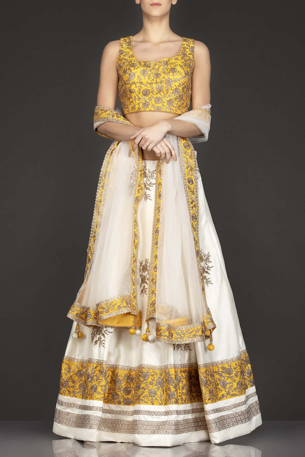 Yellow Silk Top With Ivory Silk Lehenga With Net Dupatta