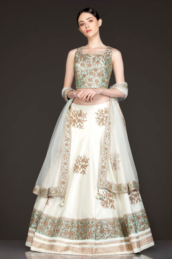 Mint Green Silk Top With Ivory Silk Lehenga With Net Dupatta