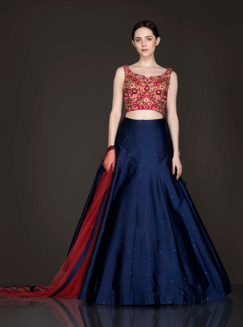 Maroon Silk Thread Work And Zari Embroidery Top With Royal Blue Silk Skirt And Maroon Net Dupatta