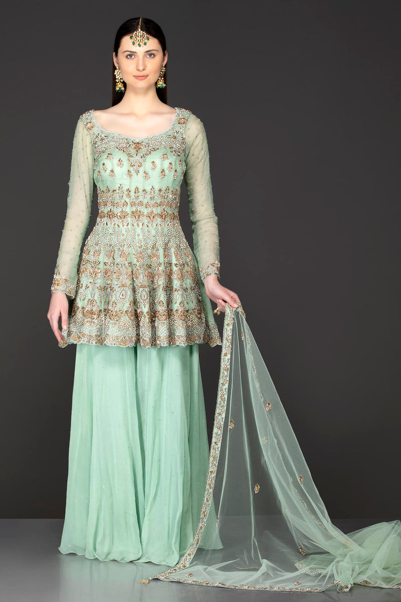 Mint Green Asymmetrical Peplum Top With Georgette Sharara And Net Dupatta