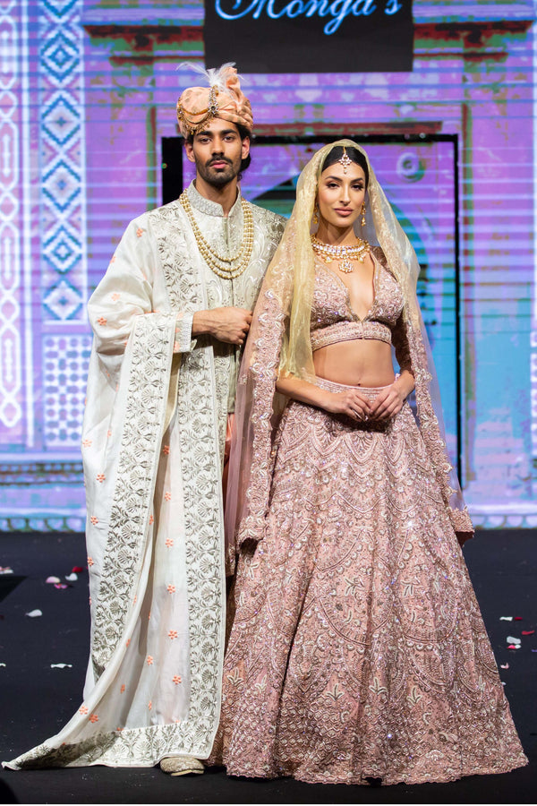 Tone-to-tone embroiderd Chogha Sherwani and Blush pink bridal lehenga