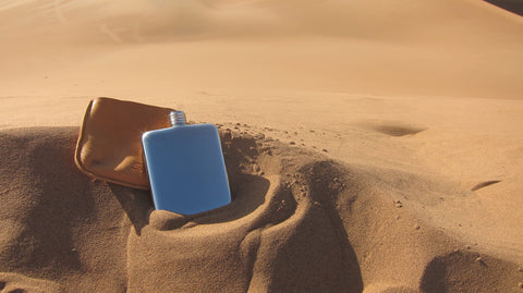 SWIG Flasks in the sand dunes