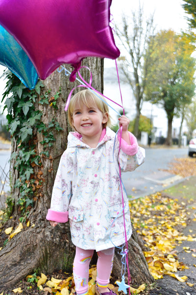 Figure 1 RM/UN - Unicorn print rain coat. Ages 1-2, 2-3, 4-5, 6-7 and 8-9.