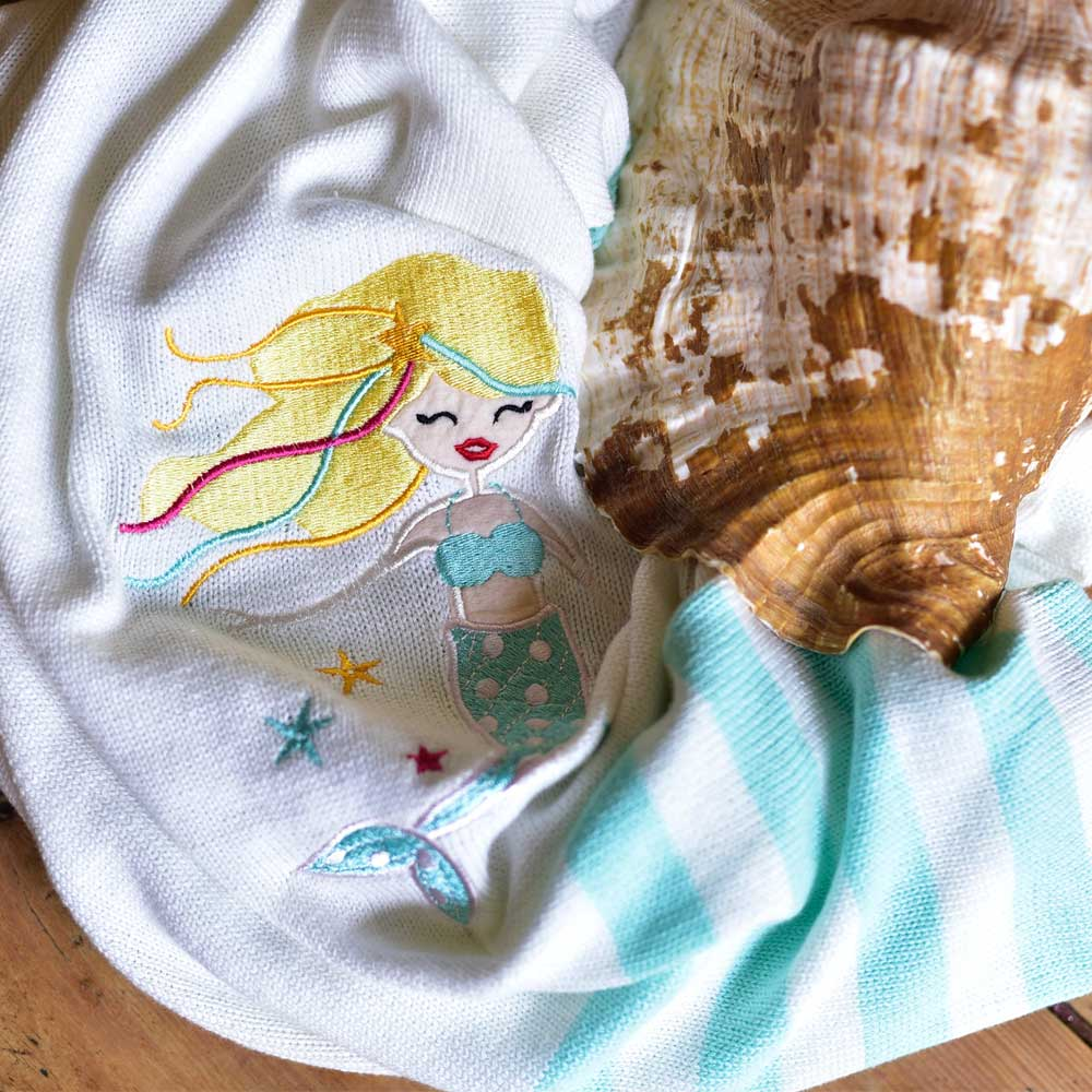 mermaid knitted cot blanket by powell craft