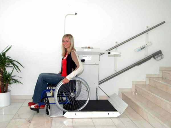 Image of woman on a wheelchair stair lift