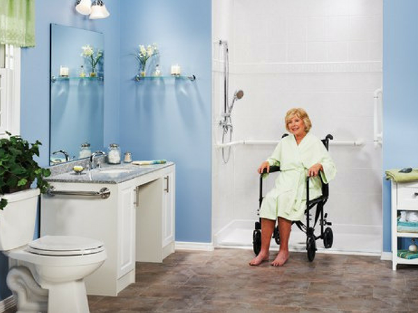 Image of a woman in a wheelchair accessible bathroom